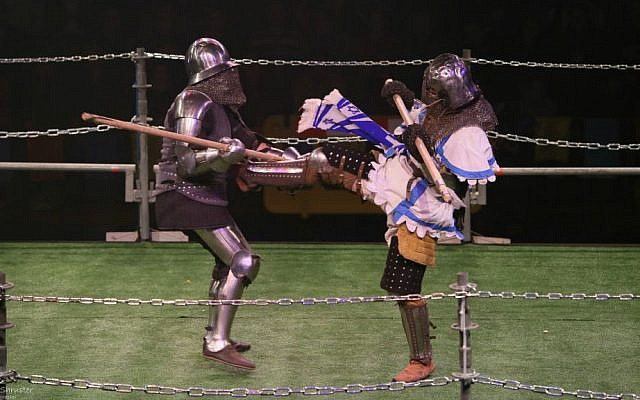 "An Israeli ""knight"" kicks his opponent at the World Medieval Fighting Championship at Rishon LeZion, January 22, 2015. (Photo credit: Ariel Shrooster)"