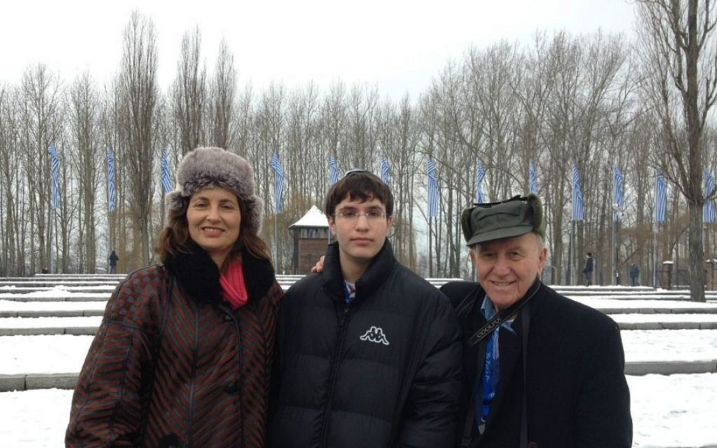 Alex Speiser, 86, from Tel Aviv, accompanied by his daughter and grandson, Etti and Roi Naor, on a tour of Auschwitz on January 28, 2015. (Amanda Borschel-Dan/Times of Israel)