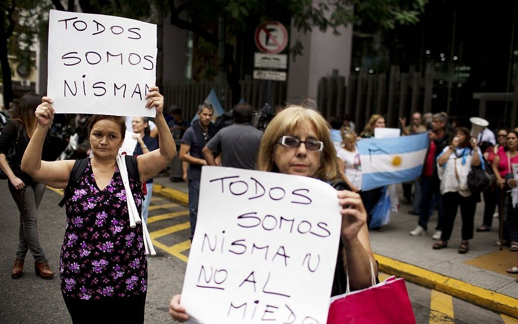Women protest while holding signs that read in Spanish 'We are all Nisman, No to Fear,' referring to the death of special prosecutor Alberto Nisman, outside Congress in Buenos Aires, Argentina, Monday, Jan. 19, 2015. (photo credit: AP Photo/Rodrigo Abd)