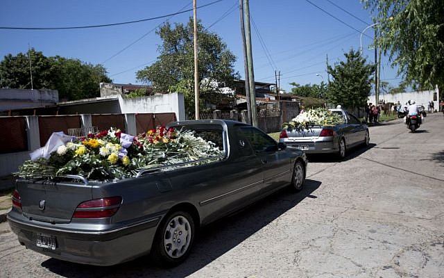 The funeral procession of late prosecutor Alberto Nisman enters the cemetery in Buenos Aires, Argentina, Thursday, Jan. 29, 2015. (photo credit: AP Photo/Rodrigo Abd)