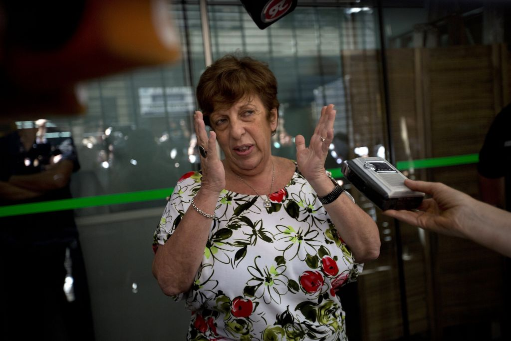 Viviana Fein, who leads the investigation of prosecutor Alberto Nisman's death, speaks with reporters outside her office, in Buenos Aires, Argentina, Thursday, Jan. 22, 2015. (photo credit: AP Photo/Rodrigo Abd)