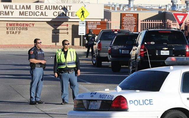 Police officers guard an entrance to the Beaumont Army Medical Center/El Paso VA campus during the search for a gunman Tuesday, Jan. 6, 2014. (Photo credit: AP/The El Paso Times, Victor Calzada)