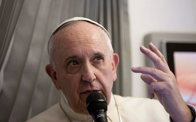 Pope Francis talks with reporters during his flight from Sri Lanka to Manila, Philippines, January 15, 2015. (photo credit: AP/Alessandra Tarantino, Pool)