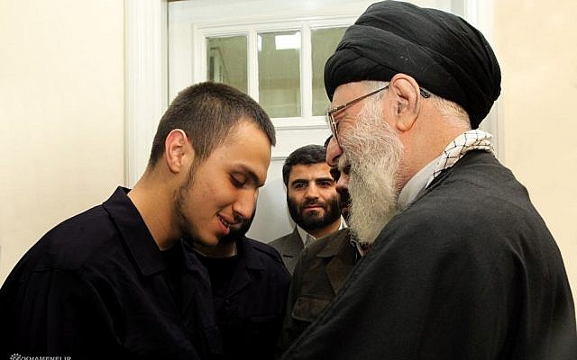 Iranian Supreme Leader Ayatollah Khamenei and Jihad Mughniyeh (photo credit: @khamenei_ir, Twitter)