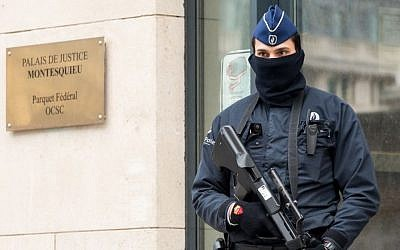 A policeman guards the Belgian Federal Prosecutor's office in Brussels, Friday, Jan. 16, 2015. (Photo credit: AP/Geert VandenWijngaert)