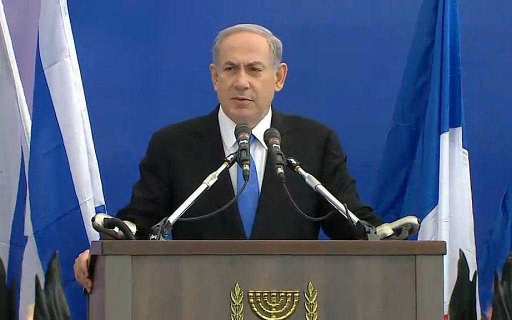 Prime Minister Benjamin Netanyahu addresses the crowd at the funeral for four French Jews killed in an attack at a kosher supermarket in Paris, January 13, 2015. (screen capture)