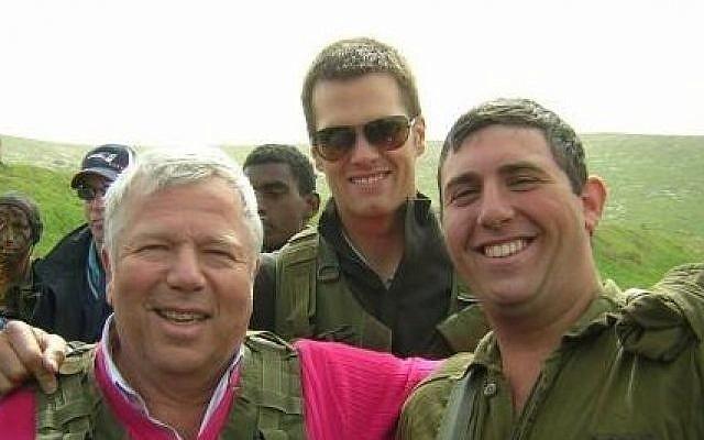 New England Patriots owner Robert Kraft and quarterback Tom Brady visit Nahal Haredi soldier Avi Sandler on his base during a 2006 trip to Israel (Courtesy)