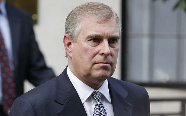 In this Wednesday, June 6, 2012 file photo, Britain's Prince Andrew leaves King Edward VII hospital in London after visiting his father Prince Philip. (AP/Sang Tan, File)