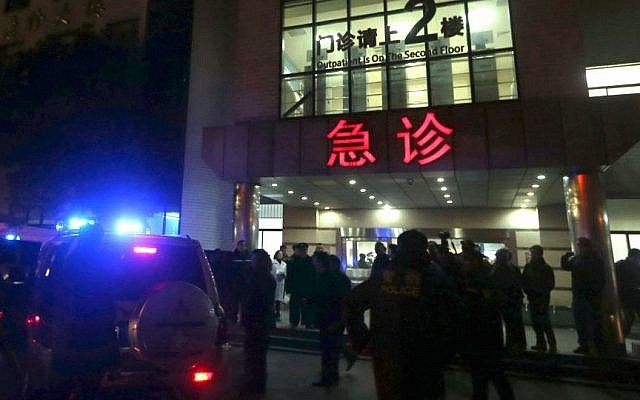 In this photo released by China's Xinhua News Agency, medical workers stand outside the emergency ward of the No. 1 People's Hospital of Shanghai after a stampede caused casualties among people who took part in New Year's celebrations in Shanghai, early on Thursday, Jan. 1, 2015. (Photo credit: AP/Xinhua, Ding Ting)
