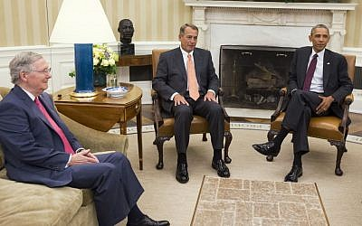 In this Sept. 9, 2014 file photo, President Barack Obama meets with Senate Minority Leader Mitch McConnell of Ky., left, and House Speaker John Boehner of Ohio in the Oval Office of the White House in Washington.  (photo credit: AP Photo/Evan Vucci, File)