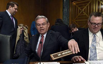Senate Banking Committee member Sen. Robert Menendez, D-N.J. (center), sitting next to Sen. Jon Tester, D-Mont. (right) at the committee's hearing on Iran sanctions, on Capitol Hill in Washington, January 27, 2015. (photo credit: AP/Susan Walsh)