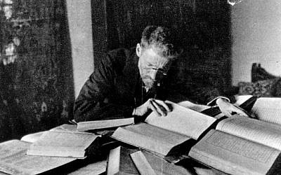 Eliezer Ben-Yehuda, credited with helping modernize the Hebrew language, at his desk in Jerusalem in 1912. (photo credit: Shlomo Narinsky, died 1960, first published 1918 in Jerusalem, via Wikimedia Commons)