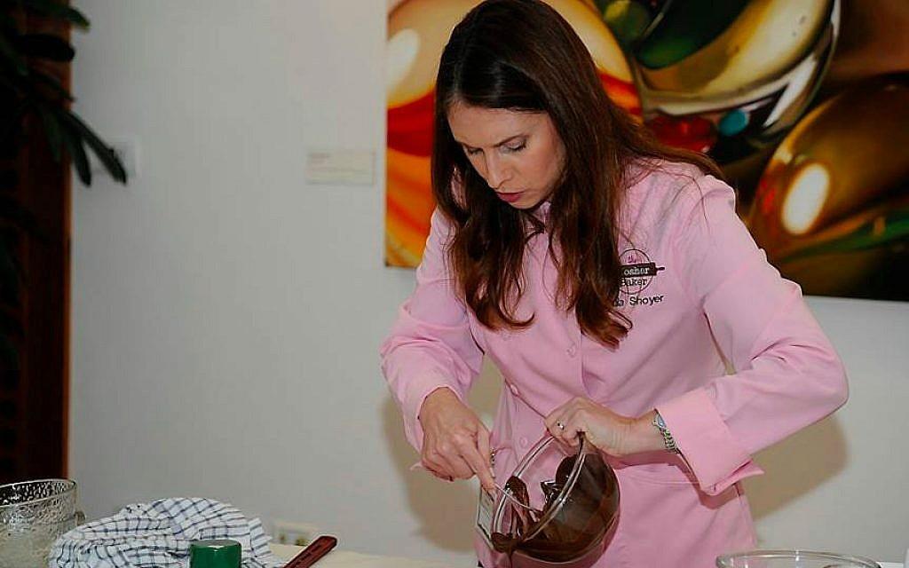 Kosher baker Paula Shoyer folding chocolate onto her Passover florentine bars (Courtesy Paula Shoyer)