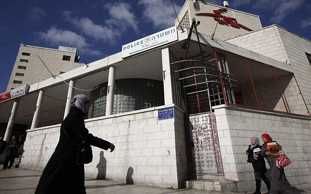 Palestinian women walk next to an Israeli post office on Salah A-din street in East Jerusalem, March 1, 2011 photo credit: Miriam Alster/Flash90