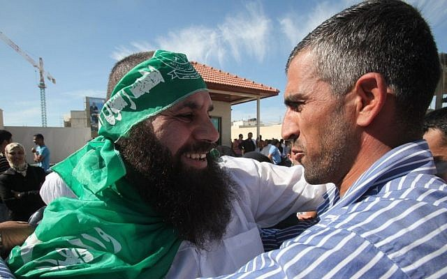 A Hamas prisoner released as part of the Shalit deal embraces his family member in Ramallah, October 18, 2011 (photo credit: Yossi Zamir/Flash90)