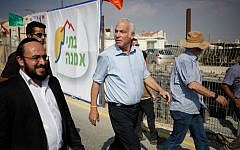Uri Ariel touring a construction site in the settlement of Kokhav Yaakov, August 2013. (Flash90)