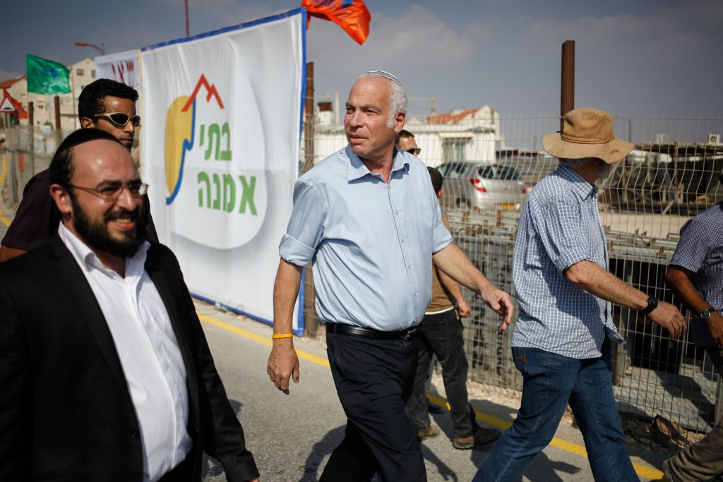 Uri Ariel touring a construction site in the settlement of Kokhav Yaakov in August 2013. (photo credit: Flash90)