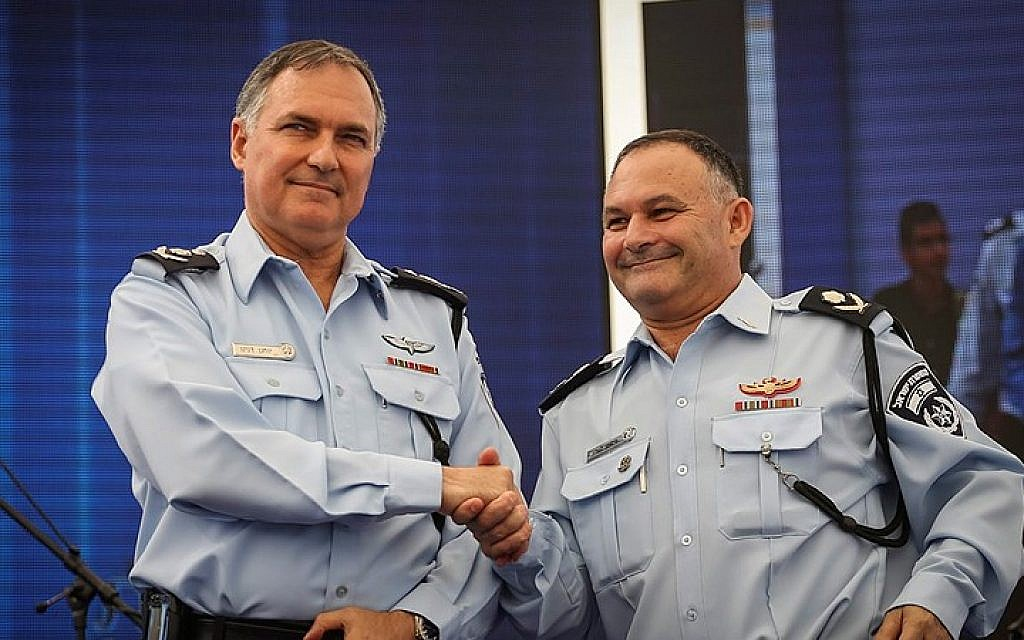 Then-Israel Police Commissioner Yohanan Danino (left) and then Deputy Commissioner Nissim Mor at a ceremony for officers receiving new ranks, at the Police headquarters in Jerusalem, September 22, 2014. (photo credit: Flash90)