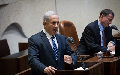 Prime Minister Benjamin Netanyahu speaks in front of the Knesset on November 26, 2014 (photo credit: Miriam Alster/FLASH90)