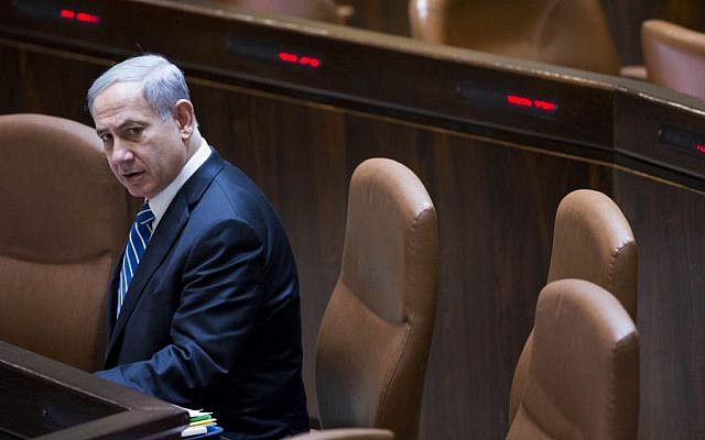 Prime Minister Benjamin Netanyahu in the Knesset during a vote on a bill to dissolve the parliament, on December 8, 2014. (photo credit: Yonatan Sindel/Flash90)