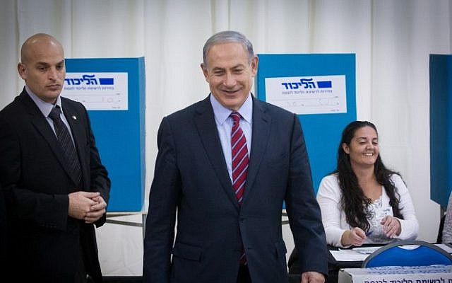 Prime Minister Benjamin Netanyahu casts his vote as his Likud party opened the polls for its primary elections on December 31, 2014. (Miriam Alster/Flash90)