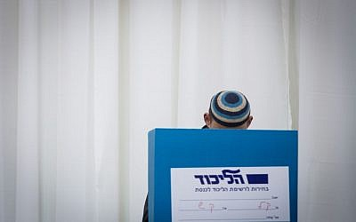 A Likud member casts his vote in the party primaries in Jerusalem, December 31, 2014. (photo credit: Miriam Alster/Flash90)