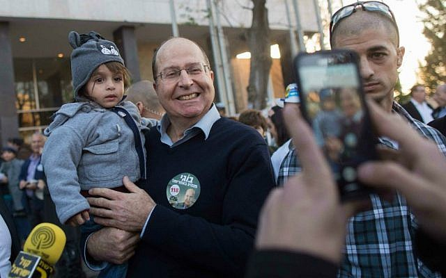 Defense Minister Moshe Ya'alon with supporters outside a Likud primary polling station in Jerusalem, December 31, 2014. (photo credit: Yonatan Sindel/Flash90)