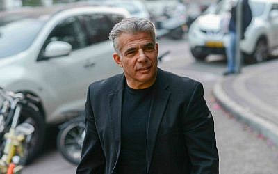 Yesh Atid leader Yair Lapid arrives at a party conference in Tel Aviv, January 1, 2015. (Ben Kelmer/FLASH90)