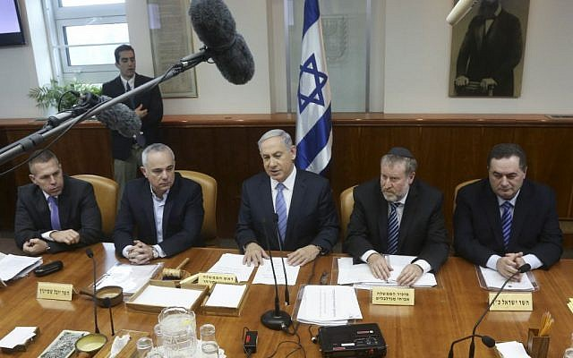 Benjamin Netanyahu, center, speaking to the cabinet on January 4, 2015. (photo credit: Marc Israel Sellem/POOL/FLASH90)