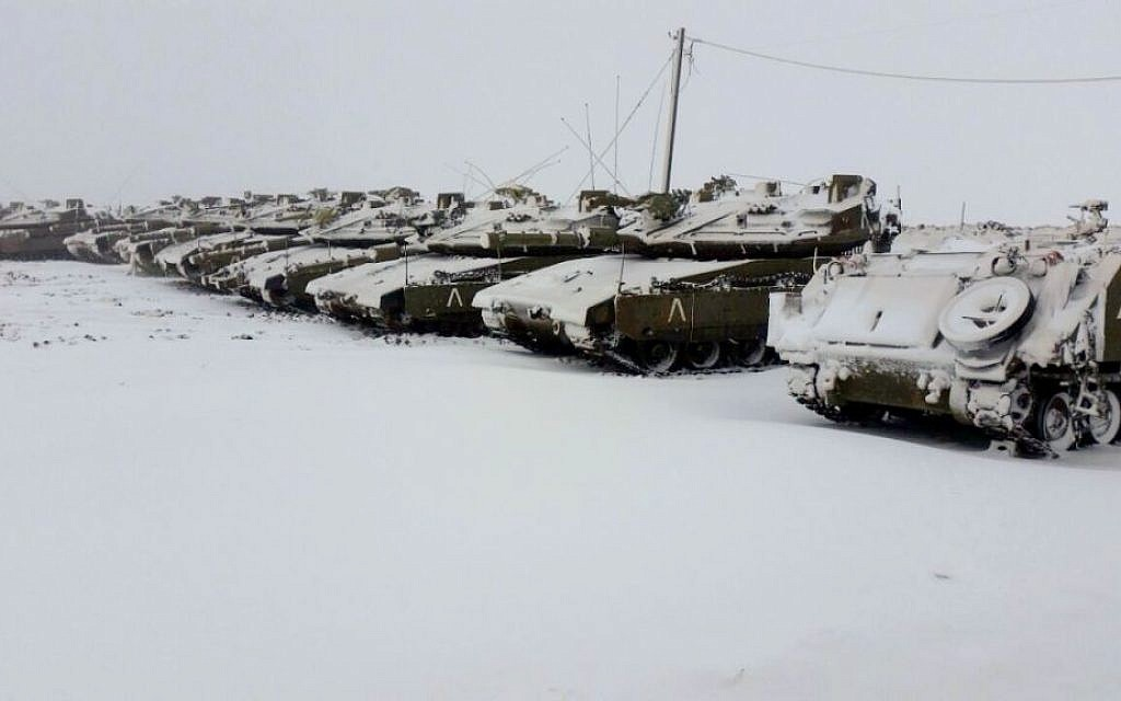 Snow-covered tanks from the IDF's 401 armed brigade, in Northern Israel on Wednesday, January 7, 2015 (photo credit: IDF Spokesperson/FLASH90)