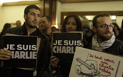 People hold signs that read 'Je suis Charlie' ('I am Charlie' at a solidarity rally at the French ambassador's residence in Jaffa, Israel, on January 8, 2015. (photo credit: Amir Levy/Flash90)