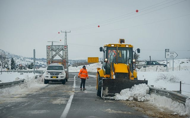 A tractor removes snow from the road in the Golan Heights on January 8, 2015. Photo by Basal Awidat/FLASH90.