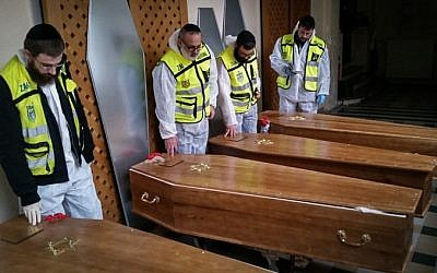 Zaka medical volunteers with the caskets of the four Jewish victims of the Paris Kosher Market terror attack, after having finished preparing the bodies for buriel, January 12, 2015 (Photo credit: Zaka Spokesperson/Flash90)