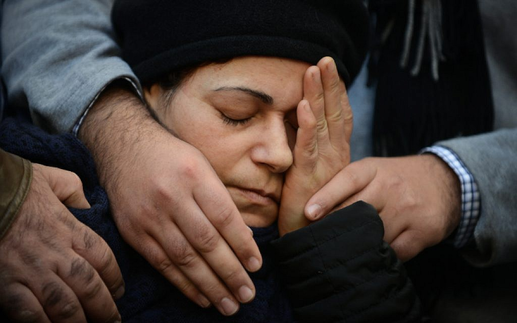 A relative mourns at the  funeral procession of Yoav Hattab, one of the four Jewish victims in the Paris Kosher market terror attack, on January 13, 2015. (photo credit: Ben Kelmer/Flash90)