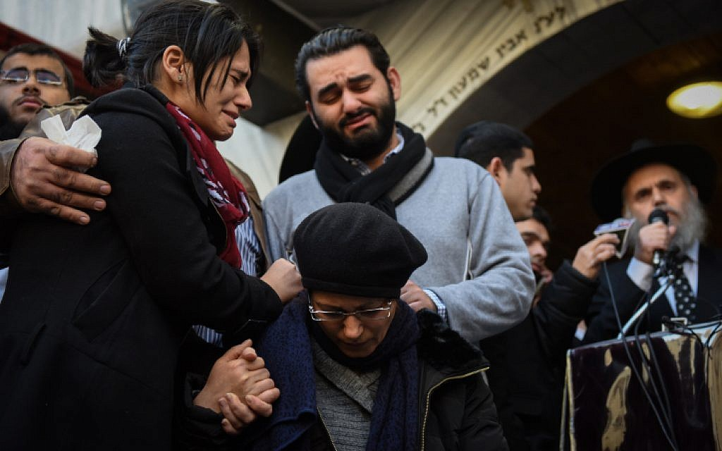 Relatives mourn at the funeral procession of Yoav Hattab in Bnei Brak on January 13, 2015. (photo credit: Ben Kelmer/Flash90)