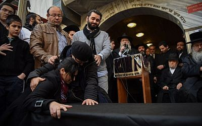 A mourner at the Jerusalem funeral for four Jewish victims of the Paris terror attacks, on January 13, 2015.  (photo credit: Ben Kelmer/Flash90)