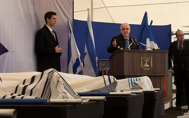Reuven Rivlin speaking at the Jerusalem funeral for the four victims of the Paris terror attack, on January 13, 2015. (photo credit: Amit Shabi/POOL/Flash90)