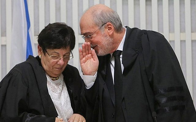 Supreme Court Chief Justice Miriam Naor seen with outgoing Deputy Supreme Court President Asher Grunis at a ceremony in Jerusalem, January 15, 2015. (photo credit: Alex Kolomoisky/Flash90)
