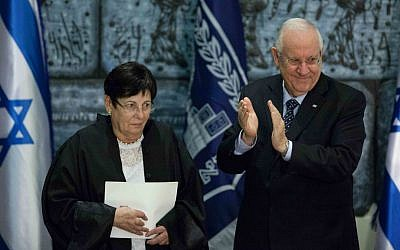 Incoming Supreme Court Chief Justice Miriam Naor with President Reuven Rivlin (R) during her swearing-in ceremony at the President's Residence in Jerusalem, January 15, 2015. (Yonatan Sindel/Flash90)