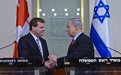 Prime Minister Benjamin Netanyahu (right) shakes hands with Canada's Minister of Foreign Affairs John Baird (left) in Jerusalem, on January 19, 2015. (photo credit: Kobi Gideon/GPO)