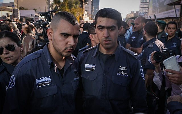Prison service officer Beni Butrashvilli and another officer speaking to the media after a terror attack in Tel Aviv on January 21, 2015. (photo credit: Flash90)