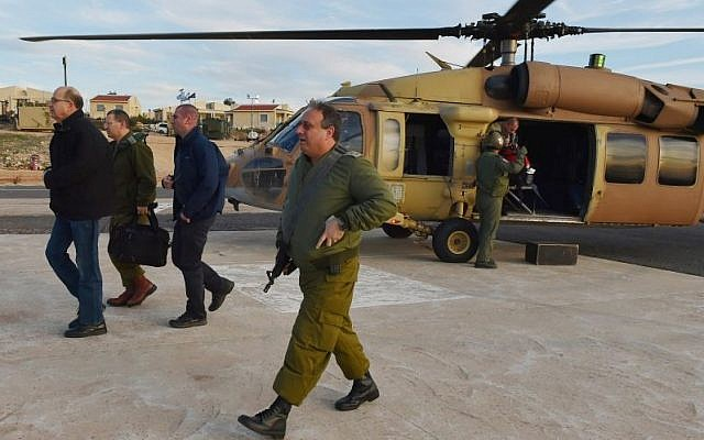 Defense Minister Moshe Ya'alon (L) tours Israel's northern region amid tensions on the Lebanese border on Friday, January 23, 2015 (Photo credit: Defense Ministry)