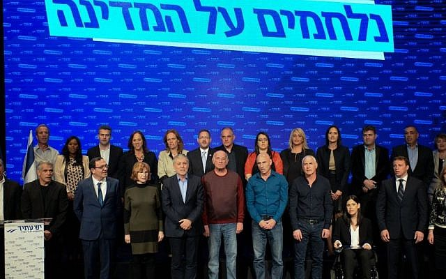 Yair Lapid, second from left in front row, with the rest of the Yesh Atid Knesset candidates, January 26, 2015. (Photo credit: Ben Kelmer/Flash90)