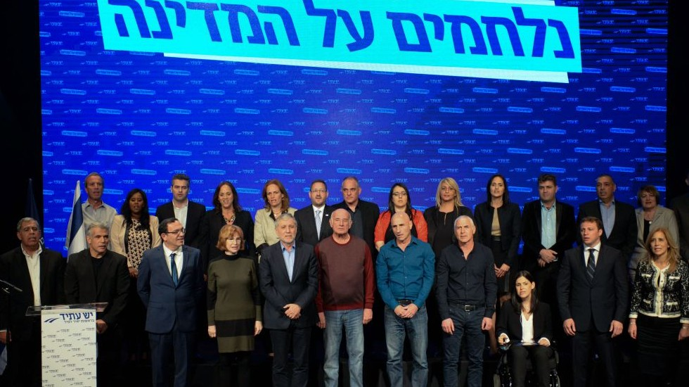 Yesh Atid leader Yair Lapid, second from left in front row, with the rest of the Yesh Atid Knesset candidates, January 26, 2015. (Photo credit: Ben Kelmer/Flash90)