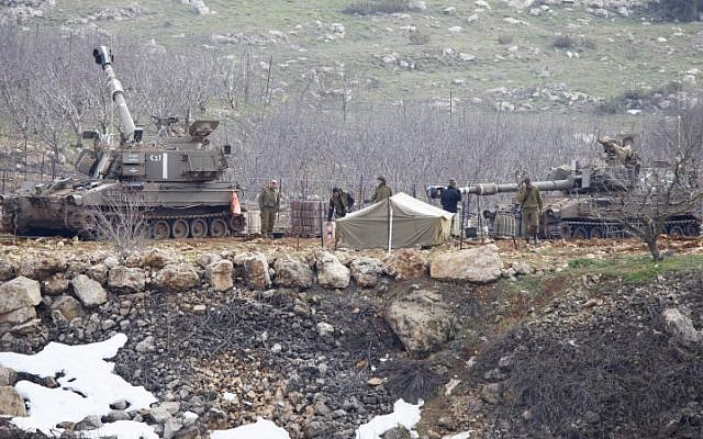 The IDF on high alert in the Golan Heights on Tuesday,  January 27, 2015 after responding with artillery fire to two rocket attacks launched from Syrian territory. (Photo credit: Basal Awidat/Flash90)