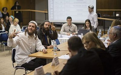Kulanu Chaverim -- Na Nach members register for the March 2015 elections, January 28, 2015. (photo credit: Yonatan Sindel/Flash90)