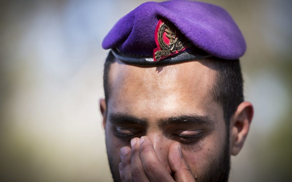 A Givati soldier at the funeral of Major Yochai Kalangel at the Mount Herzl Military Cemetery in Jerusalem on January 29, 2015. Major Yochai Kalangel was killed a yesterday in a Hezbollah attack on his vehicle on Israel's border with Lebanon. (Photo credit: Yonatan Sindel/Flash90)