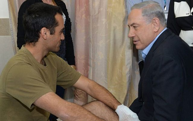 Prime Minister Benjamin Netanyahu visits wounded soldiers at Rambam hospital in Haifa, on January 30, 2015, following their injury in a January 28 Hezbollah attack in northern Israel near the Lebanese border. (Photo credit: Amos Ben Gershom/GPO)