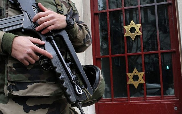 A soldier stands guard outside a synagogue in Neuilly-sur-Seine, outside Paris, France, January 13, 2015. (AP/Christophe Ena)