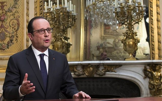 French President Francois Hollande, poses after addressing his New Year's wishes to the nation during a pre-recorded broadcast speech at the Elysee Palace, in Paris, Wednesday, Dec. 31, 2014. (Photo credit: AP/Ian Langsdon, Pool)
